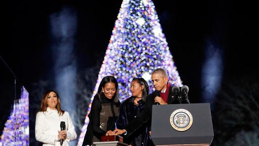 President Barack Obama, first lady Michelle Obama and their daughter Sasha light the 2016 National Christmas Tree during the National Christmas Tree lighting ceremony at the Ellipse near the White House in Washington, Thursday, Dec. 1, 2016. Also on stage is the host Eva Longoria.