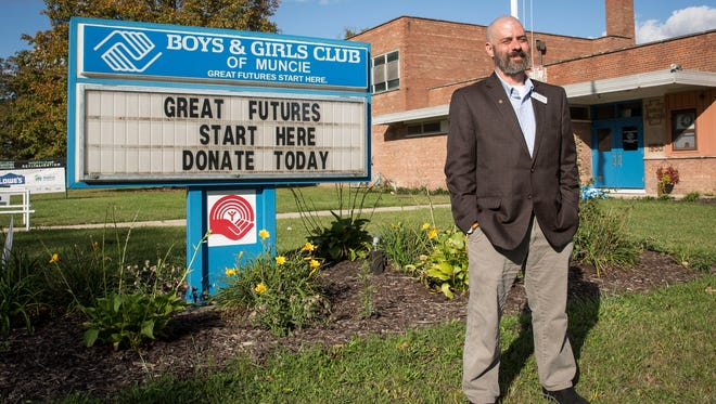 Jason Newman, the new CEO at Boys & Girls Club, stand in front of their building Oct. 16 on the city's southside.