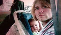 Kurt Cobain with daughter Frances Bean Cobain in a