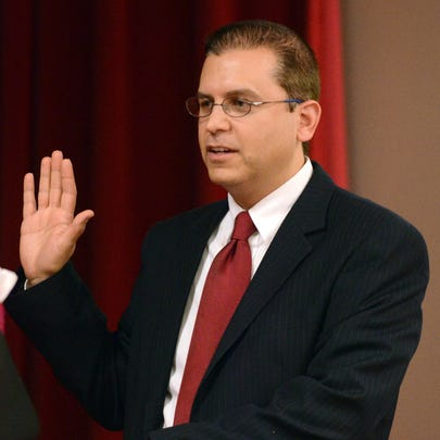 Michael Fracassa takes the oath of office to represent