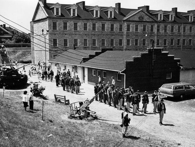 Reenactors march on the grounds of Historic Fort Wayne