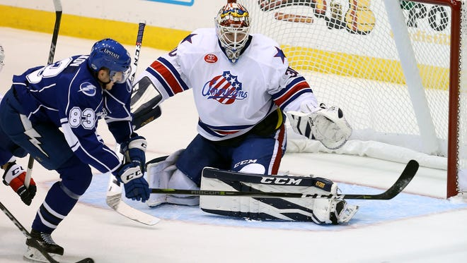Rochester goalie Linus Ullmark slide across the crease as Syracuse's Alexander Volkov chase the puck.