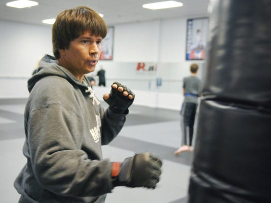Taekwondo black belt Stephen Rueber practices on a