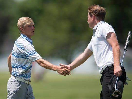Castle's Adam Bratton shakes hands with North's Stewie