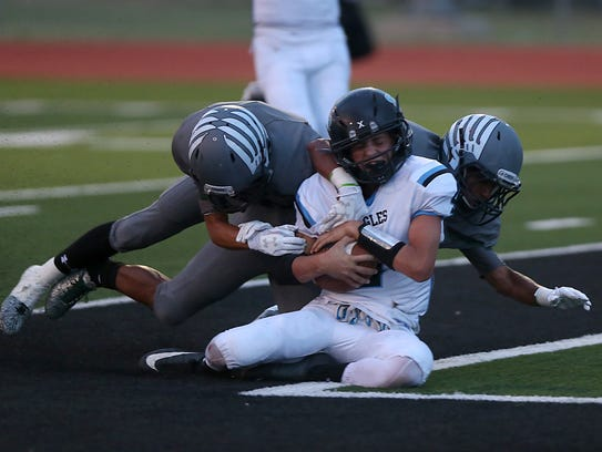 TLCA Eagle Kaiden Kirkland is tackled in the end zone