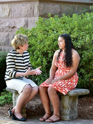 Susan Davis speaking with Yisel Mendez, who she mentors.