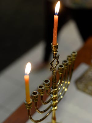 A menorah lit for the first day of Hanukkah at the York Jewish Community Center Tuesday, December 16, 2014.