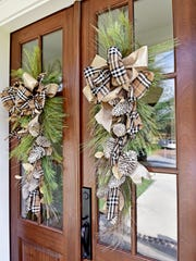 Wreaths from Celebrations adorn the front doors and