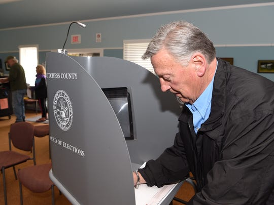Dutchess County Sheriff Butch Anderson votes at Pawling Town Hall.