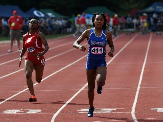 Hamilton Southeastern's Camille Christopher crosses the finish line to win her heat of the 100 meter dash during the girls IHSAA track and field state finals at Robert C. Haugh Track and Field complex in Bloomington, Ind. on Friday, May, 1, 2018.