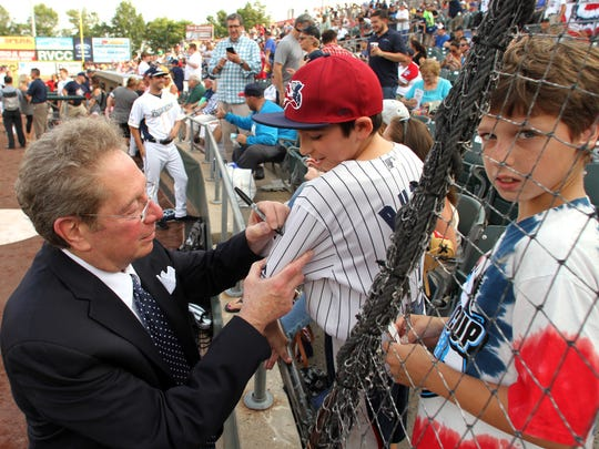 Voice of the Yankees, John Sterling signs an autograph before the game at the 2017 Atlantic League All-Star Game hosted by the Somerset Patriots at TD Bank Ballpark. July 12, 2017. Bridgewater, NJ.