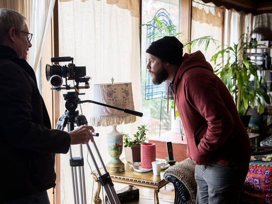 """Professional filmmaker and instructor Brad Hoover, left, discusses exposures with filmmaking student Ryan DuVal, right, while shooting the film """"House of KaBam"""" along with his classmates Saturday Dec. 3, 2016."""