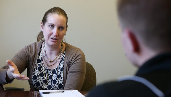 Beth Jeffries, Career Center assistant director, works with graduate Ryan Hohensee on interview skills earlier this month at St. John Fisher College in Pittsford.
