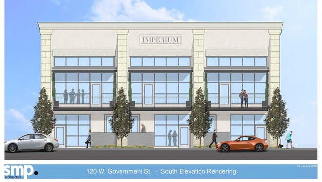 A rendering of the mixed-use office space and townhome development at 120 W. Government St.