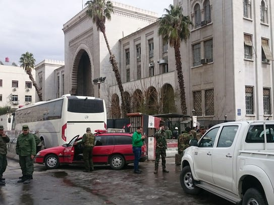 Syrian security forces cordon off the area following