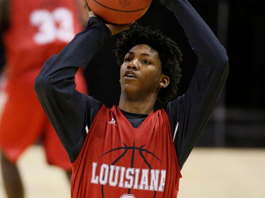 UL guard Elfrid Payton (2) shoots during practice before the second round of the 2014 NCAA Tournament at AT&T Center.