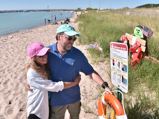 Jamie Racklyeft and his fiancee Susie McGraw view rescue equipment at Van's Beach in Leland, Mich. Friday, July 6, 2018.