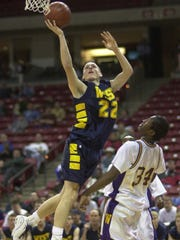 Wausau West's Justin Hardel goes up for a shot during