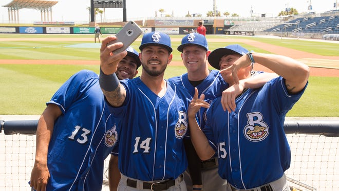 Biloxi Shuckers, from left, Yadiel Rivera, Nick Ramirez, Tyler Wagner and Tyrone Taylor take a selfie during practice at the Pensacola Blue Wahoos' stadium in Pensacola, Fla., Wednesday, April 8, 2015.