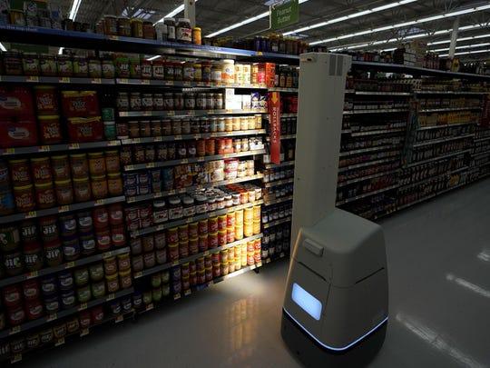 In this Nov. 9, 2018, file photo, a Bossa Nova robot