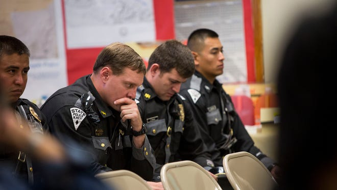 Friends and family of slain Shiprock Police officer Alex Yazzie of the Navajo Tribe mourn his death March 20, 2015 in Crownpoint, New Mexico. Yazzie, who died late Thursday night due to a fatal gunshot wound, was responding to a domestic violence call in the area. The funeral for Yazzie will be held in Farmington, New Mexico Friday, March 27.