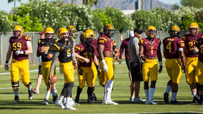 ASU football players warm up during spring football practice on March 28, 2015 in Tempe.
