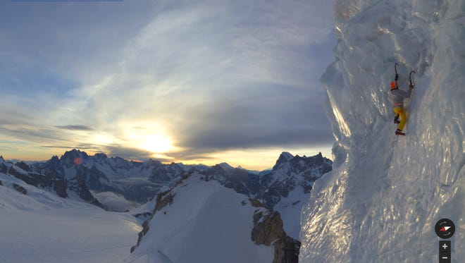 Alpine climber Ueli Steck ascends an ice sheet on Mont Blanc as people watch from below in this undated image provided by Google.