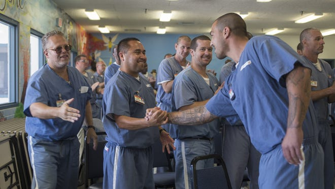 Gavel club members congratulate Lee Martino after his speech about what the Gavel club meant to him at the Wakulla Correctional Instituiton Annex on Friday. Members of the club are comprised of inmates at the correctional institution.
