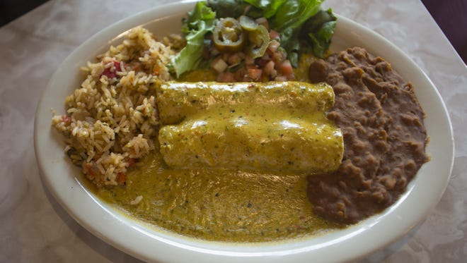 """A chicken enchilada dish called """"Chicka Chicka Boom Boom""""  is a house favorite at Chuy's Restaurant. The Tex-Mex restaurant located on 904 E. Lafayette St is set to open on May 10, 2016."""