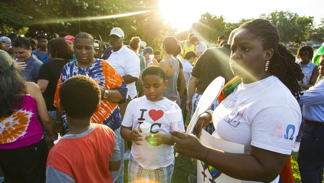 More than 100 people gathered at Lake Ella on Sunday for a vigil in honor of the lives lost during the mass shooting in Orlando.