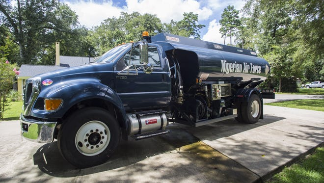 A Bowser Refueling Truck spreads across the driveway of Bcgneeds CEO, Justice Chuku. The truck services fuel for military planes.