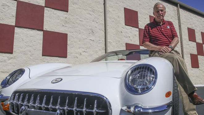 Car enthusiast and Tallahassee Auto Museum owner DeVoe Moore sits atop his 2003 Chevrolet Corvette retrofitted with the body of the 1953 make of the car. Moore and his wife, Shirley, will serve as grand marshals of the FSU Homecoming Parade this Friday .