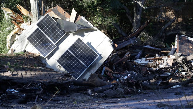 Solar panels from a destroyed home and debris are shown in Montecito, Calif., Wednesday, Jan. 10, 2018.