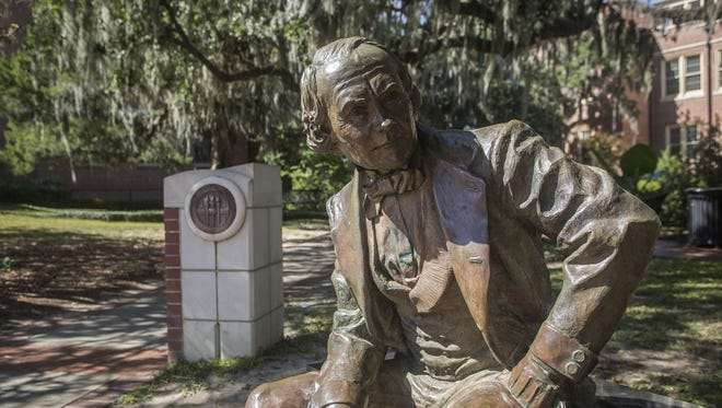 A statue of Francis Eppes lies next to Westcott Fountain and in front of Eppes Hall on FSU's campus.