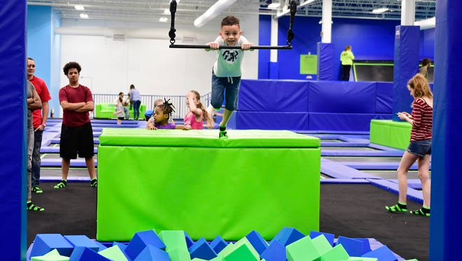 Omar Vega, 9, from West Manchester Township swings into a foam pit at Adrenaline Entertainment Center in West Manchester Township. Adrenaline Entertainment Center's grand opening was on May 12, 2018. The indoor trampoline park is located at 2150 White Street in York.