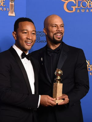 """John Legend, left, and Common pose in the press room with the award for best original song """"Glory"""" in a film for """"Selma"""" at the 72nd annual Golden Globe Awards at the Beverly Hilton Hotel on Sunday, Jan. 11, 2015, in Beverly Hills, Calif. (Photo by Jordan Strauss/Invision/AP)"""
