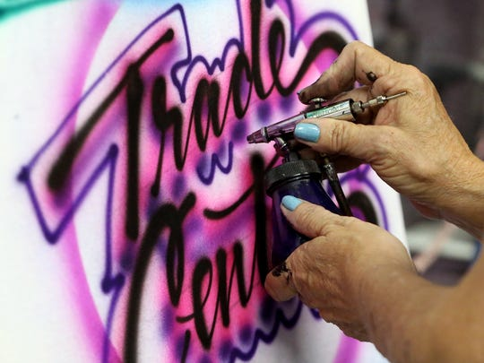 Darla Hagensick hand paints a shirt Friday, Aug. 12, 2016, at the Corpus Christi Trade Center in Corpus Christi.