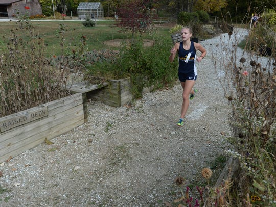 Seton Catholic's Jenna Barker runs in the regional