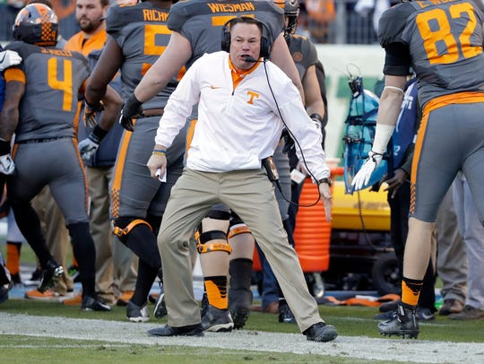 Tennessee coach Butch Jones congratulates players after