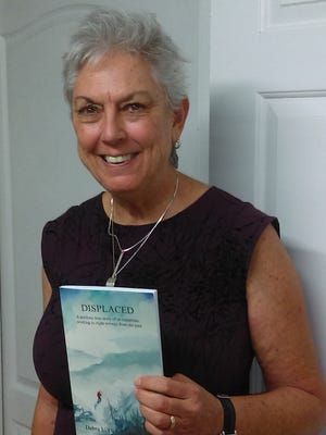 """Debra L. Gish will hold a reading and signing of her book """"Displaced: A perilous true story of an expatriate working to right wrongs from the past""""  during the Downtown Visalia First Friday Art Walk from 5-8 p.m. Nov. 3 at the Brandon-Mitchell Gallery."""