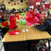 Phoenix Magnet Elementary second-graders look at Valentine's Day cards they made for patients at Rapides Regional Medical Center. The cards will be placed on patients' lunch trays Sunday.