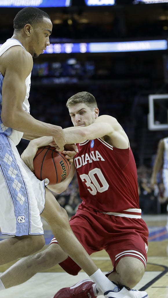 Indiana Hoosiers forward Collin Hartman (30) ties the ball up with North Carolina Tar Heels forward Brice Johnson (11) for a jump ball in the second half of their semifinal game in the East regional of the NCAA Tournament Friday, Mar 25, 2016, evening at Wells Fargo Center in Philadelphia PA. The North Carolina Tar Heels defeated the Indiana Hoosiers 101-86.