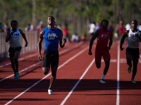 Martin County's Morgan Jamison (left of center) comes in first in his heat, and overall, in the boys 100-meter dash during the District 9-4A track and field meet Monday, April 16, 2018, at Port St. Lucie High School. Jamison later took first in the 200 and 400-meter events at the meet, which included athletes from Treasure Coast, St. Lucie West Centennial, Fort Pierce Central, Vero Beach and Melbourne high schools participated in the meet.