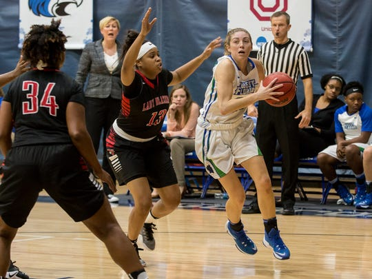 West Florida's Belle Bistrow, right, tries to get around Valdosta State's Jazmyn McIntosh (13) during the first conference game of the season Monday night at UWF.