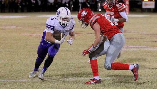 Hunter Jackson of the Jacksboro Tigers runs for yardage