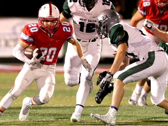 South Salem's Ricky Villarreal (20) rushes with the ball in the second half of the West Salem vs. South Salem football game at South Salem High School on Friday, Oct. 21, 2016. West Salem won the game 45-9.