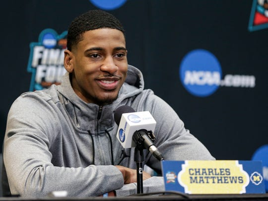 Michigan guard Charles Matthews answers a question from a reporter at the Alamodome in San Antonio, Texas, Friday, March 30, 2018.