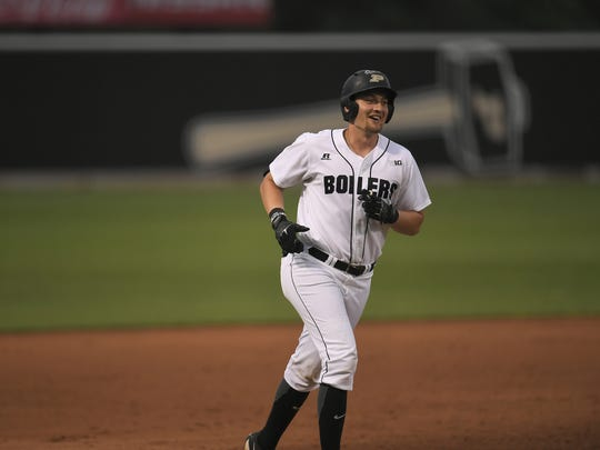 Purdue senior designated hitter laughs as he rounds