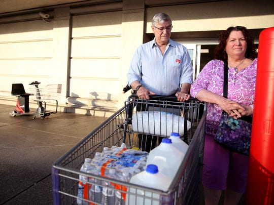 "Mark Schonbrun, 72, and Linda Schonbrun, 66, of West Salem, purchase water following a tap water contamination warning for people in Salem at WinCo Foods on Lancaster in Salem on Tuesday, May 29, 2018. ""People were pushing; it was a madhouse,"" Mark Schonbrun said."