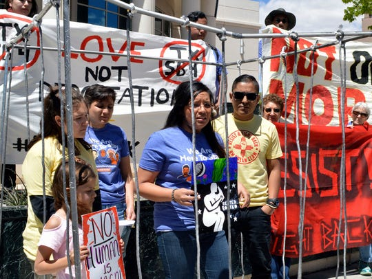 In this May 1, 2017 file photo, immigrant rights advocates